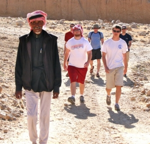 Musa leading group Petra Jordan Tour