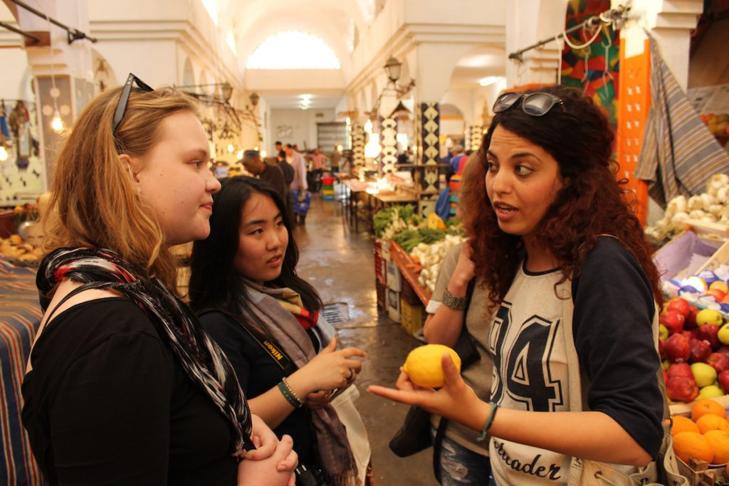 Travelers learn about life in the Sousse Medina at a local souq
