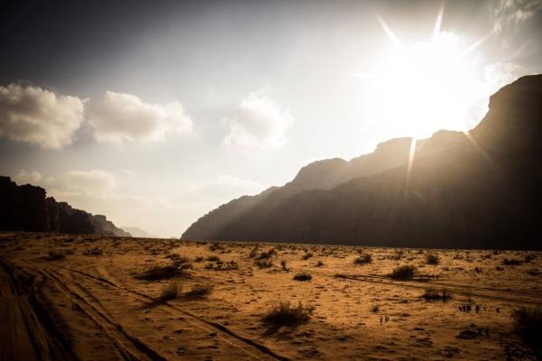 Wadi Rum vista: sun peeking over the mountains