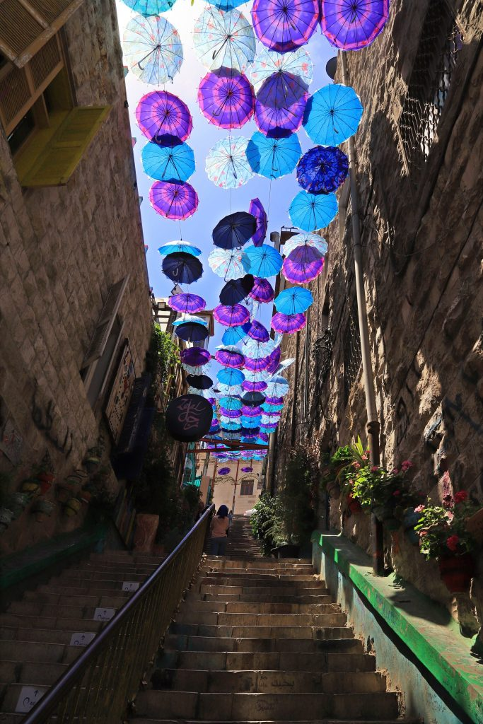 umbrellas covering a street in Amman Jordan