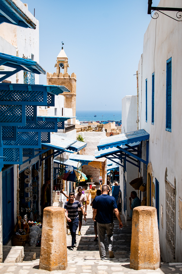 People walk to and from local shops near Bab il Gharbi in the Sousse Medina Tunisia
