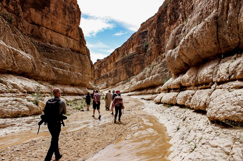 Travelers hiking in Mides canyon southern Tunisia