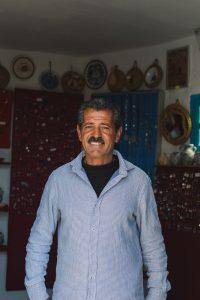 Souvenir shop seller in Takrouna Tunisia