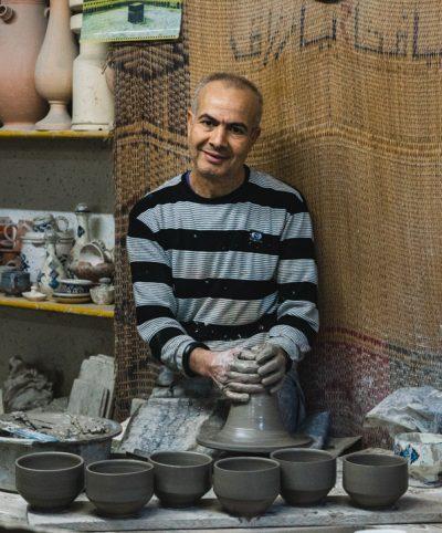 Potter Turns Clay on wheel in Nabeul Tunisia
