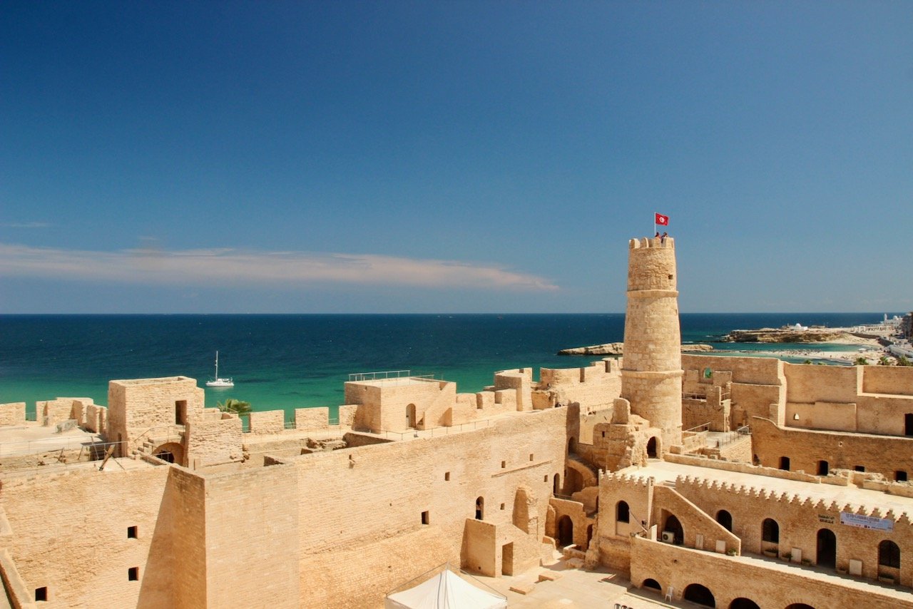 The Monastir Ribat (Islamic fortress) with turquoise waters of the Mediterranean Sea in the background