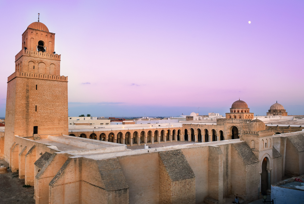 The moon rises over Kairouan's Great Mosque