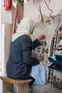 Weaver working at a loom in Kairouan